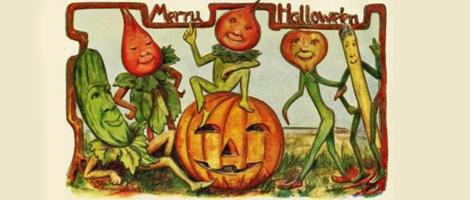 A vintage postcard of pumpkin-headed sprites dancing around a jack o'lantern